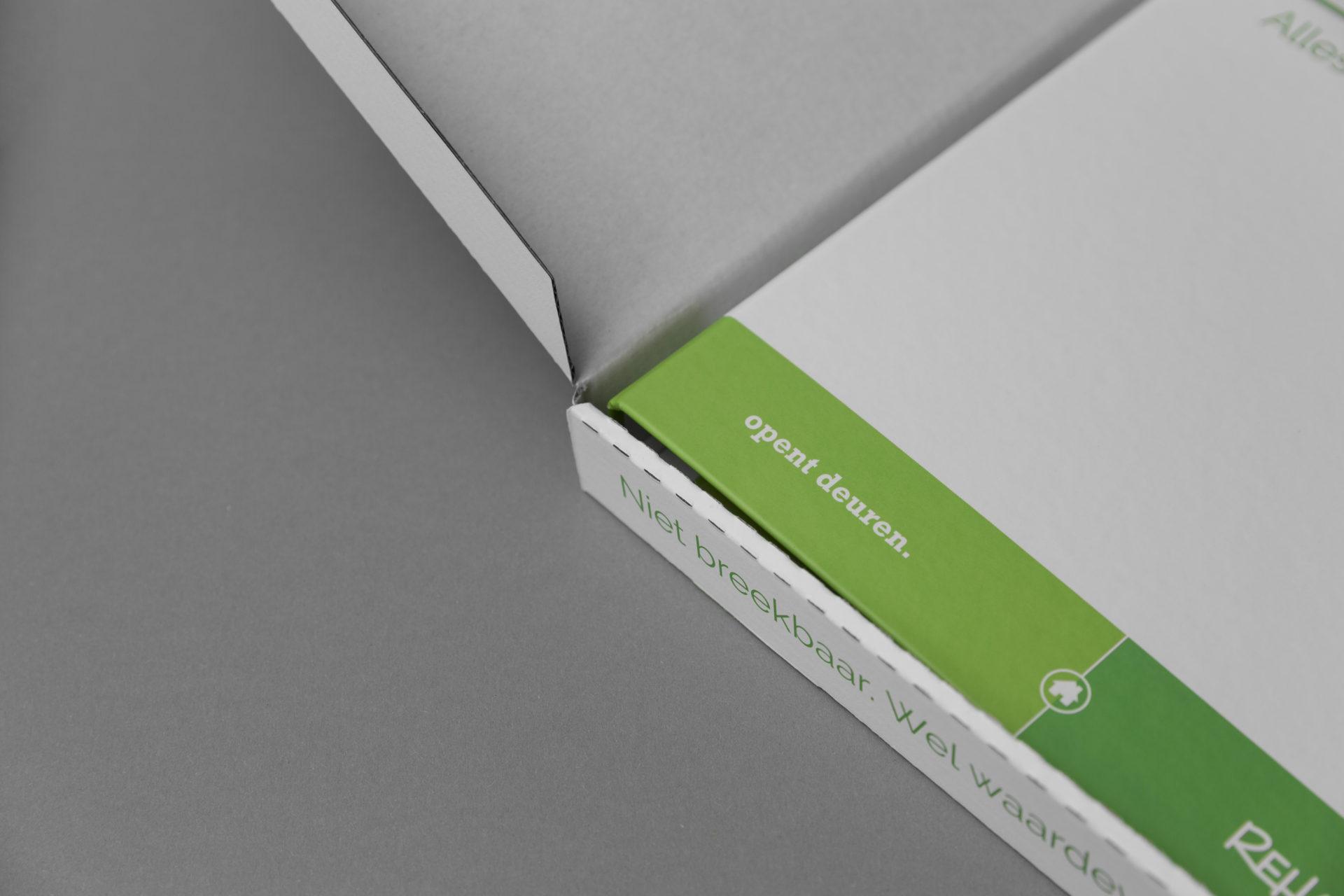 Ringband Reham met tabbladen en verzendverpakking